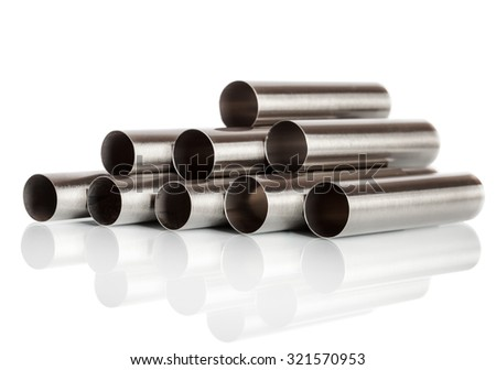 Stack of metal pipes. Chrome steel tubes isolated on white background - stock photo