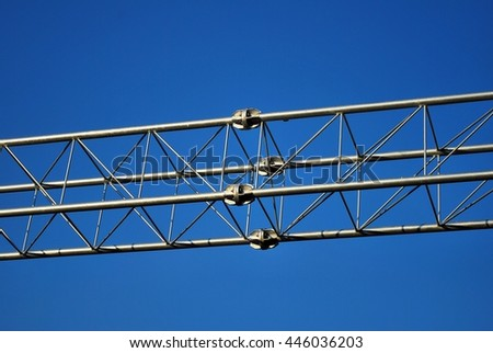 Stack of metal trusses for mounting the stage - stock photo