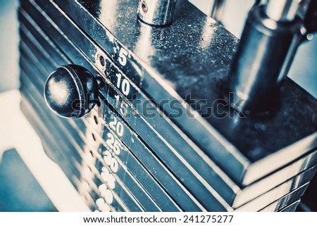 Stack of  metal weights in gym bodybuilding equipment - stock photo