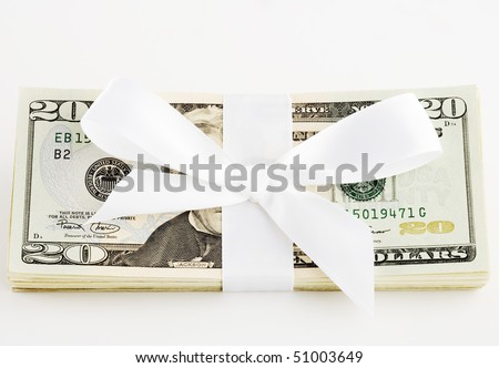 Stack of money with a bow around it - stock photo