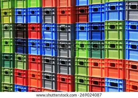 Stack of multicolor crates. Abstract background - stock photo
