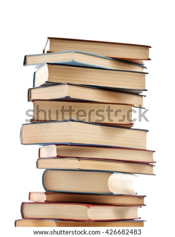 Stack of new and old books isolated on white - stock photo
