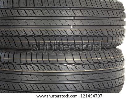 Stack of new tires. Brand new tires stacked up, isolated on white background - stock photo
