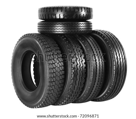 Stack of new tires. Isolated - stock photo