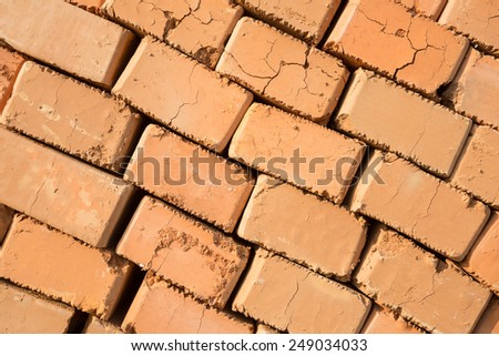 Stack of new unused bricks ready for construction - stock photo