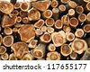 Stack of newly felled pine tree trunks still oozing resin, harvested by lumberjacks in the forest - stock photo