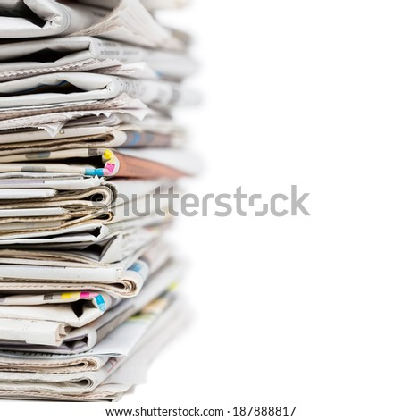 Stack of newspapers isolated on white. Breaking news, journalism, power of the media, newspaper and magazine ads and subscription concept. Great as a web page banner, article illustration and more. - stock photo