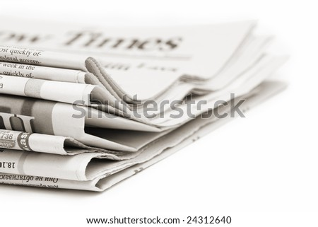 stack of newspapers, toned - stock photo