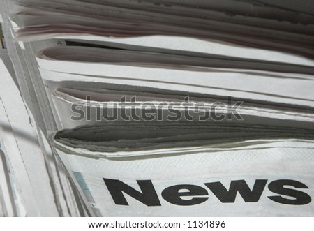 Stack of newspapers with focus on the word 'news' on top paper. - stock photo