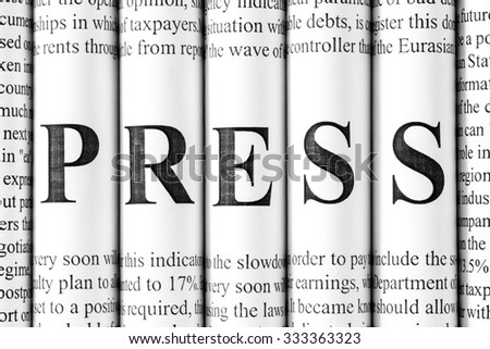 "Stack of newspapers with small text and big letters forming together word ""PRESS"" - stock photo"