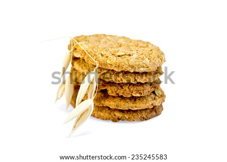 Stack of oatmeal cookies with a stalk of oats isolated on a white background - stock photo