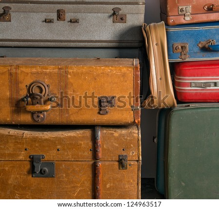 stack of of vintage suitcases - stock photo