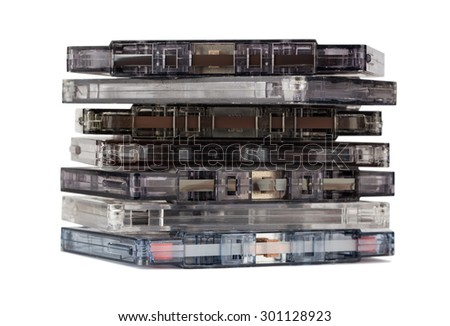 Stack of old audio cassettes isolated on white background - stock photo