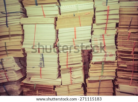 stack of old books and documents pile up together in retro color - stock photo