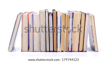 Stack of old books isolated on white background. - stock photo