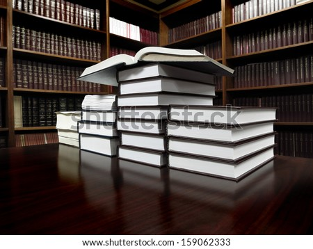 Stack of old books on a desk or table in a library - stock photo