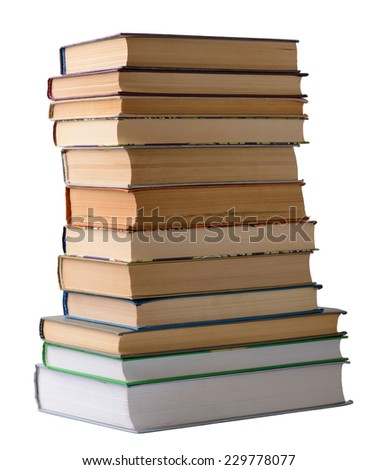 stack of old books on a white background closeup - stock photo