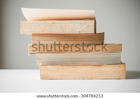 Stack of old books on table - stock photo