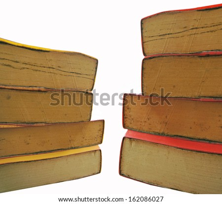 stack of old books on white background - stock photo