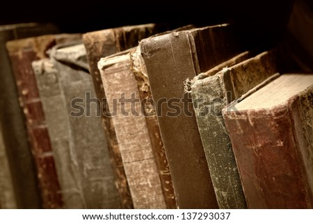 stack of old books. shallow DOF - stock photo