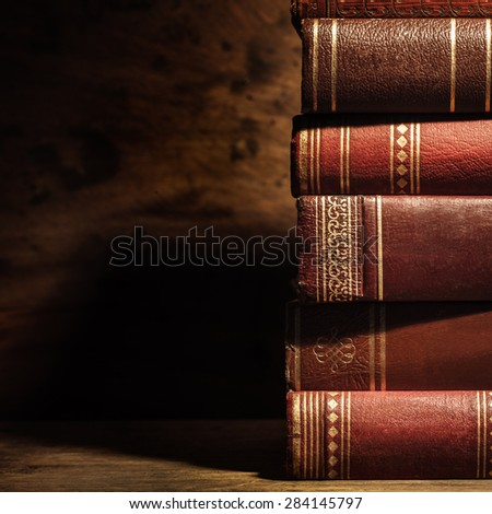 stack of old books with copyspace - stock photo