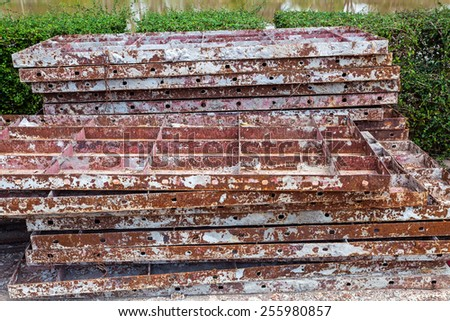Stack of old brown iron rust for construction background - stock photo