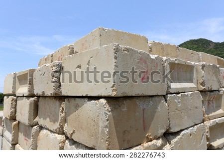 Stack of old concrete blocks against a blue sk - stock photo