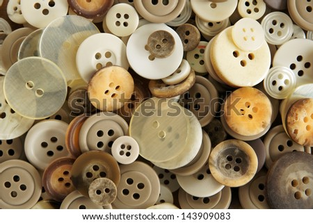Stack of old fashioned brown beige and white buttons  - stock photo
