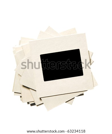 stack of old film slides, isolated on white - stock photo