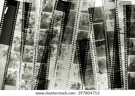 Stack of old films on the light background.Used black and white filter. - stock photo