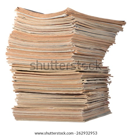 Stack of old magazines on a white - stock photo
