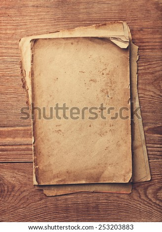 stack of old papers on wood textures background - stock photo