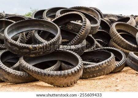 Stack of old wheel black tyre texture background. - stock photo