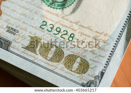 Stack of one hundred dollar bills close-up - stock photo