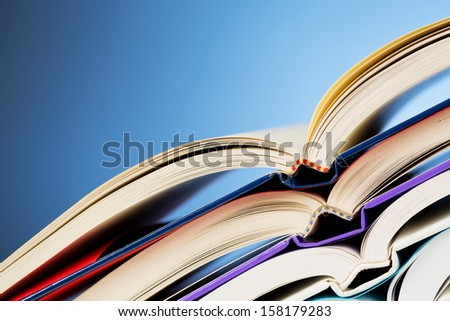 Stack of open textbooks with copy space. An image about school and education. - stock photo