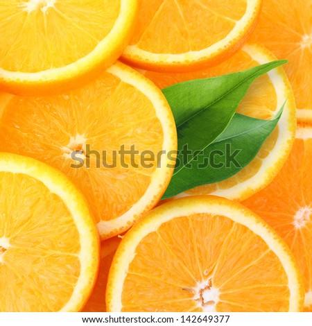 Stack of orange fruit slices background. - stock photo
