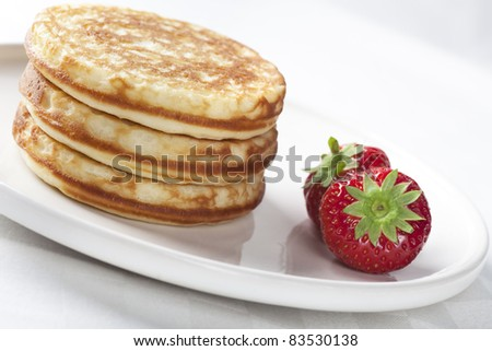 Stack of pancakes fresh off the griddle ready for butter and syrup. - stock photo