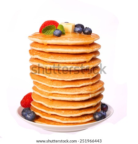 Stack of Pancakes Strawberry and Blueberry isolated on white - stock photo