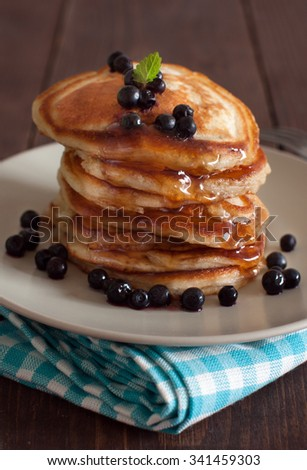 Stack of pancakes with blueberries and maple syrup - stock photo