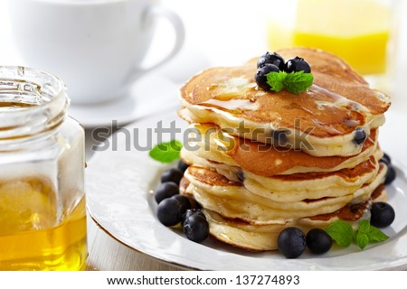 Stack of pancakes with fresh blueberry - stock photo