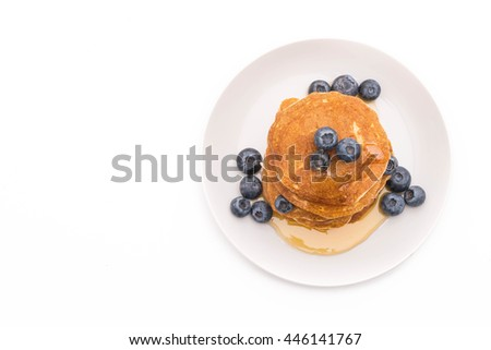 Stack of pancakes with fresh blueberry on white background - stock ...