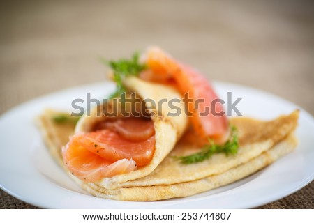 stack of pancakes with salted salmon on a plate - stock photo