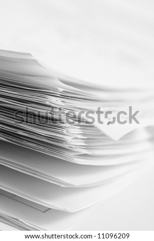 Stack of papers on white background - stock photo