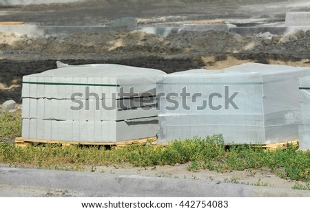 Stack of paving stone on construction site - stock photo