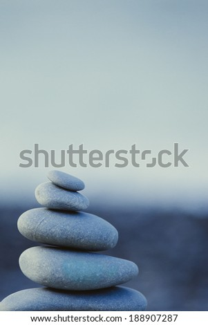 Stack of pebbles in a beach - stock photo
