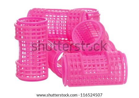 Stack of pink hair curlers isolated on white background - stock photo