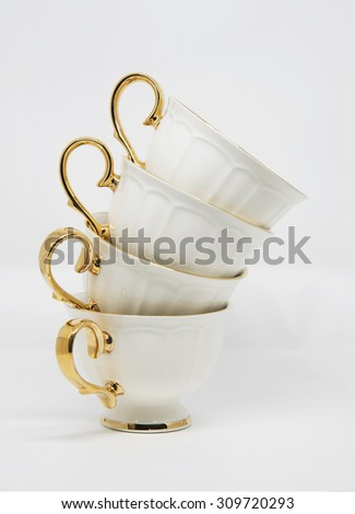 stack of porcelain tea cups on white background - stock photo