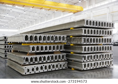 Stack of precast reinforced concrete slabs in a house-building factory workshop - stock photo