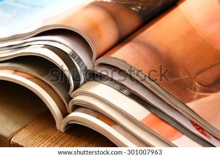 stack of printed magazines - stock photo