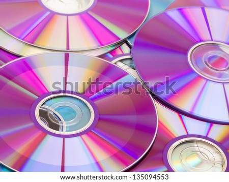 Stack of purple rewritable dvd collection - stock photo